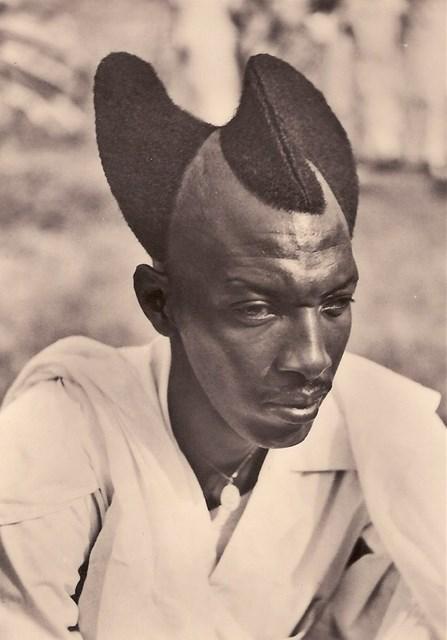 Rwandan man with Amasunzu hairstyle, 1923.